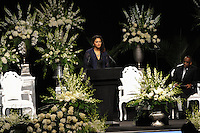 Natasha Mundkur, a student and volunteer at the Muhammad Ali Center, speaks at the memorial service for boxing legend Muhammad Ali at the KFC Yum! Center in Louisville, Kentucky on June 10, 2016.  Ali was involved in the planning of the ceremony which included speeches from leaders of numerous faith as well as comedian Billy Crystal and former American President Bill Clinton.
