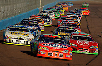 Nov 13, 2005; Phoenix, Ariz, USA;  Nascar Nextel Cup drivers Jeff Gordon and Jeremy Mayfield lead the field back to the green on a restart during the Checker Auto Parts 500 at Phoenix International Raceway. Mandatory Credit: Photo By Mark J. Rebilas