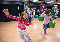 NWA Democrat-Gazette/BEN GOFF @NWABENGOFF<br /> Karis Roland (left), 7, of Rogers and cousin Cadence Chambers, 8, of Springdale dance during a choreography exercise Tuesday, March 19, 2019, during the 'Broadway in Bentonville' spring break day camp at Trike Theatre in Bentonville. Kindergarten through 6th grade students develop their acting, singing and dancing skills studying a popular Broadway musical each day of the camp.