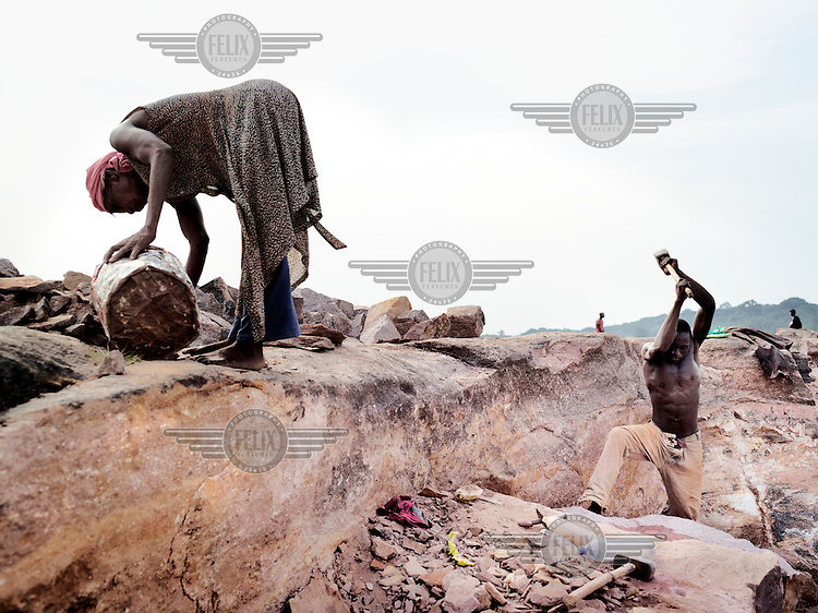 On the banks of the Congo River near Kinshasa people work in a quarry.