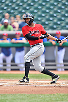 Birmingham Barons left fielder Eloy Jimenez (21) swings at a pitch during a game against the Tennessee Smokies at Smokies Stadium on May 6, 2018 in Kodak, Tennessee. The Smokies defeated the Barons 6-2. (Tony Farlow/Four Seam Images)