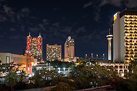 This is an image of the San Antonio skyline with the Tower of Americas, the Torch of Friendship, and the many high rise hotels like the Marriott, Grand Hyatt, Hilton to name a few in the downtown part of the city.