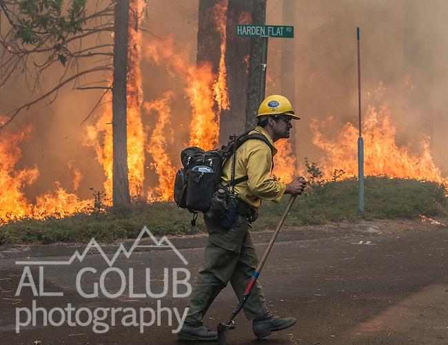 Kern County Hotshot monitors spot fire on Harden Flat Road near Highway 120.