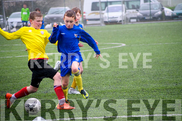 Seanie Diggin wins the ball from Holycross AFC in Killorglin AFC U12s 5-2 victory on Saturday.
