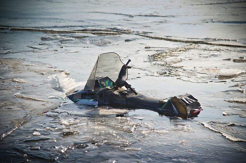 A submerged snowmobile where it fell through the ice of Lake Michigan.
