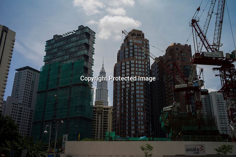 One of the Petronas tower is seen against the construction in Kuala Lumpur, Malaysia. Photo: Sanjit Das/Panos