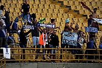 BOGOTA - COLOMBIA - 01 - 03 - 2018: Hinchas de Emelec (ECU), animan a su equipo durante partido entre Independiente Santa Fe (COL) y Emelec (ECU), de la fase de grupos, grupo 4, fecha 1 de la Copa Conmebol Libertadores 2018, jugado en el estadio Nemesio Camacho El Campin de la ciudad de Bogota. / Fans of Emelec (ECU), cheer for their team during a match between Independiente Santa Fe (COL) and Emelec (ECU), of the group stage, group 4, 1st date for the Conmebol Copa Libertadores 2018 at the Nemesio Camacho El Campin Stadium in Bogota city. Photo: VizzorImage  / Luis Ramirez / Staff.