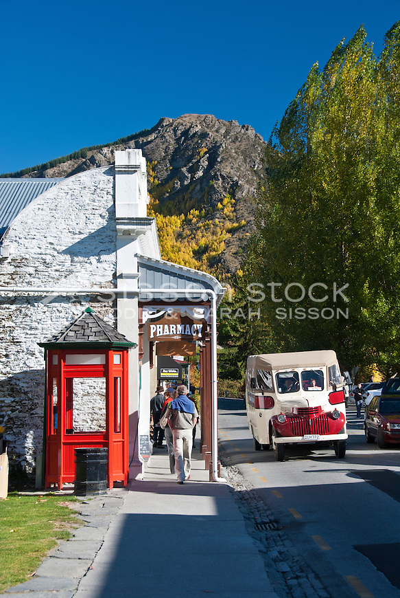 Looking down the main street of historic Arrowtown up  to Autumn trees on the hills, Central Otago, South Island, New Zealand