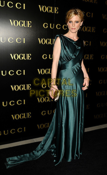 EMILIA FOX .A dinner in honour of Frida Gianni, Creative Director of Gucci, hosted by Alexandra Shulmanand at the Saatchi Gallery, Duke of York's Headquarters, King's Road, Chelsea, London, England..April 1st, 2009 .Vogue full length green dress silk satin long maxi clutch bag gold clutch bag .CAP/CAN.©Can Nguyen/Capital Pictures.