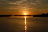Sunset in January over barrier islands near Ozona Florida on the Gulf of Mexico. Sunset on the Gulf of Mexico near Ozona Florida.
