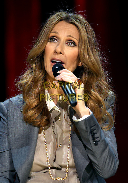 CELINE DION.Celine Dion's Momentous Return To The Colosseum Press Conference At Caesars Palace Resort Casino, Las Vegas, Nevada, USA..March 15th, 2011.headshot portrait grey gray jacket gold  necklace beige shirt blouse microphone .CAP/ADM/MJT.© MJT/AdMedia/Capital Pictures.