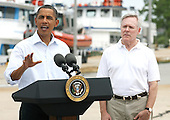 United States President Barack Obama speaks at a Coast Guard base next to Secretary of the Navy Ray Mabus in Panama City, Florida USA on Saturday, 14 August  2010. The First Family is visiting the area to help promote tourism and check up on clean up efforts from the aftermath of the Deepwater Horizon Oil spill.  .Credit: Dan Anderson / Pool via CNP