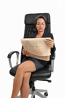 Businesswoman rading financial newspaper (Licence this image exclusively with Getty: http://www.gettyimages.com/detail/106421917 )