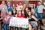 Kevin Maguire and Mags Gaynor (front) and a group of climbers from the Kerry 4 Peaks Challenge presenting a cheque to Conor Cusack, Kerry Hospice Foundation, at the Dingle Bay Hotel, Dingle, on Saturday night.