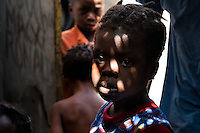 A little orphan girl waits to be given food in the Orphanage Bon Samaritain in Croix-Des-Bouques, Haiti, 12 July 2008. Many families in Haiti are economically not able to care of their children. Sometimes the parents simply let the children abandoned on the street and never come back. These babies usually end in an orphanage (if they are not refused because in Haiti all kind of refuges are generally overfull). Although children living in an orphanage may be lucky for having at least a bed, most of them suffer from hunger and have to share clothes with the other orphans. Unicef estimates that there are around half a million orphans in Haiti.