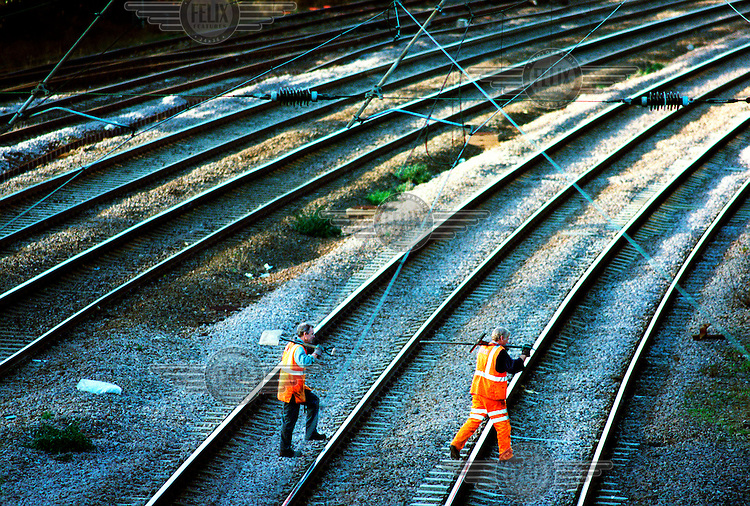 Railtrack contractors work on a railway line near Cricklewood..