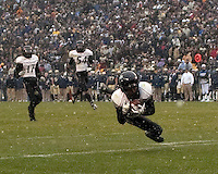 Cincinnati Bearcats defensive back Dominique Battle makes an interception. The Cincinnati Bearcats defeated the Pittsburgh Panthers 45-44 in the final seconds of the River City Rivalry in a contest for the Big East Championship and a major bowl bid on December 5, 2009 at Heinz Field, Pittsburgh, Pennsylvania. .