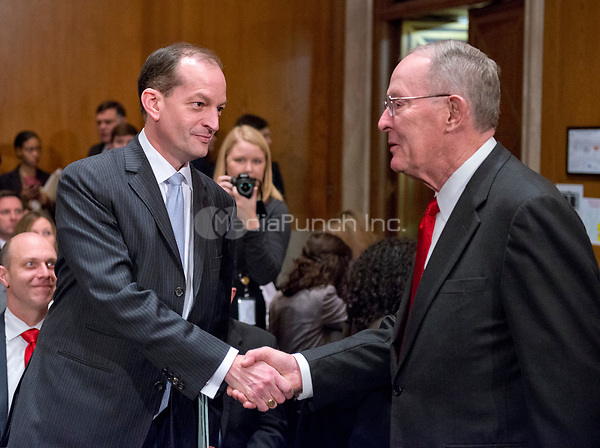 United States Senator Lamar Alexander (Republican of Tennessee), Chairman of the US Senate Committee on Health, Education, Labor &amp; Pensions, right, welcomes R. Alexander Acosta, Dean of Florida International University College of Law and US President Donald J. Trump's nominee for US Secretary of Labor, as Mr. Acosta arrives for his confirmation hearing before the committee on Capitol Hill in Washington, DC on Wednesday, March 22, 2017.<br /> Credit: Ron Sachs / CNP /MediaPunch