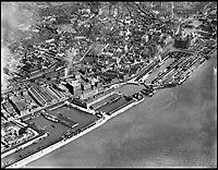 BNPS.co.uk (01202 558833)<br /> Pic: Aerofilms/HistoricEngland/BNPS<br /> <br /> Prince's Dock, Liverpool, 27 May 1937.<br /> <br /> Stunning historic aerial photos of seaside towns, naval bases, ports and shipyards which tell the story of Britain's once-great maritime tradition feature in a new book.<br /> <br /> The fascinating archive of black and white images includes views from a bygone age such as Brighton's famous West Pier, Grimsby's burgeoning fishing fleet, and London's dock yards.<br /> <br /> Iconic ships were also captured from the skies including the Cutty Sark in its final seaworthy years on the Thames, HMY Britannia in 1959, the RMS Queen Mary in 1946 and the SS Queen Elizabeth in 1969 about to make her maiden voyage.<br /> <br /> England's Maritime Heritage from the Air, by Peter Waller, is published by English Heritage and costs &pound;35.