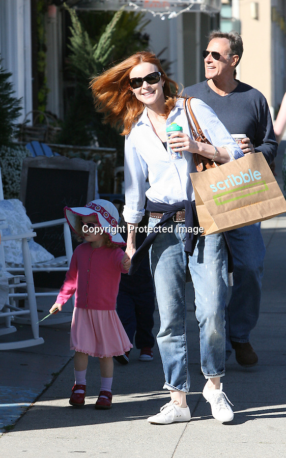 AbilityFilms@yahoo.com.805-427-3519.www.AbilityFilms.com...4-30-2010 ..Marcia Cross & husband Tom Mahoney shopping in Los Angeles with her kids Eden and Savannah. Marcia went shopping at a store called Scribble & took some pictures of her children playing.
