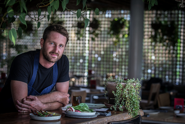 6 DECEMBER, 2019 BALI, INDONESIA: Australian head chef at The Slow in Canggu, Daniel Metcalfe (from Byron Bay) shows off some dishes from his menu. There has been a levelling out of Australian tourist numbers to Bali in recent times and tastes are changing regarding what people want from their holiday. Millennials are being targeted by tourism authorities and they want to give them more boutique experiences than just beach and beer. Picture by Graham Crouch/The Australian