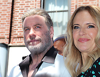 "12 June 2018, New York, USA: The US Hollywood star John Travolta and his wife, actress Kelly Preston, celebrate in front of the food stall ""Lenny's Pizza"" on 86th Street in Bensonhurst with colleagues and numerous fans. Travolta bought two slices of Margehrita in his role of Tony Manero in the classic disco movie ""Saturday Night Fever"" some 40 years ago. Photo: Christina Horsten/dpa /MediaPunch ***FOR USA ONLY***"