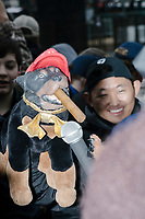 Triumph the Insult Comic Dog (Robert Smigel) interviews people as they gather near the National Mall to watch the inauguration of President Donald Trump on Jan. 20, 2017, in Washington, D.C.