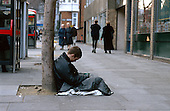 A homeless young man begs in central London.