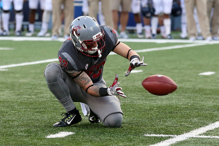 Kaleb Fossum, Washington State holder, concentrates on the snap during the Cougars Pac-12 Conference demolition of the Arizona Wildcats, 69-7, on November 5, 2016, at Martin Stadium in Pullman, Washington.