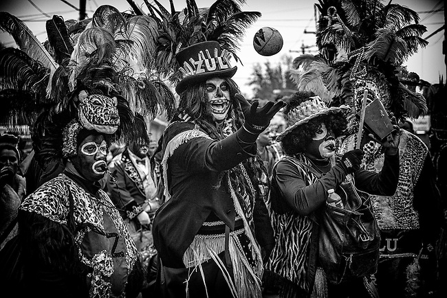 Zulu Tramp Stephen Rue with a hand-painted coconut, the most sought after throw, while marching in the Zulu Social Aid & Pleasure Club's 'Zulu Parade' on Jackson Avenue, the first parade on the morning of Mardi Gras Day on February 12, 2013 in New Orleans, Louisiana.