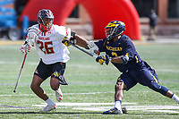 College Park, MD - April 1, 2017: Maryland Terrapins Isaiah Davis-Allen (26) holds off Michigan Wolverines Chase Young (3) during game between Michigan and Maryland at  Capital One Field at Maryland Stadium in College Park, MD.  (Photo by Elliott Brown/Media Images International)