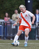 Syracuse University forward Emil Ekblom (14) crosses the ball. Boston College (maroon) defeated Syracuse University (white/orange), 3-2, at Newton Campus Field, on October 8, 2013.