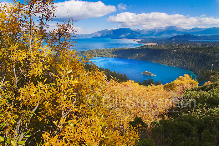 A photo of willow trees in fall color and Emerald Bay in Lake Tahoe California