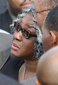 Landover, MD - October 26, 2002 --  Sonia Wills, mother of slain bus driver Conrad Everton Johnson, departs the Glendale Baptist Church following his funeral.<br /> Credit: Ron Sachs / CNP<br /> (RESTRICTION: NO New York or New Jersey Newspapers or newspapers within a 75 mile radius of New York City)