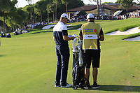 Justin Rose (ENG) and caddy Mark Fulcher prepare to play his 2nd shot on the 18th hole at the end of Sunday's Final Round of the 2018 Turkish Airlines Open hosted by Regnum Carya Golf &amp; Spa Resort, Antalya, Turkey. 4th November 2018.<br /> Picture: Eoin Clarke | Golffile<br /> <br /> <br /> All photos usage must carry mandatory copyright credit (&copy; Golffile | Eoin Clarke)