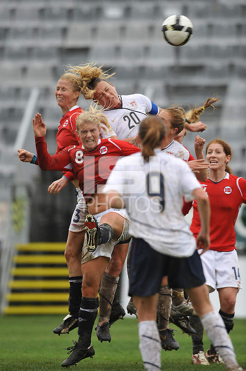US forward Abby Wambach wins a header over the Norwegian defense at a the 2010 Algarve Cup game in Olhao, Portugal.