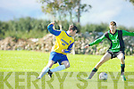 Fenit Samphires Fionn Griffin and Classic FC's Danny carroll in action in the Munster junior cup at Fenit on Sunday.