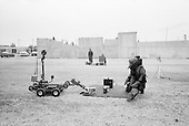 Mexico City, Mexico<br /> June 17, 2008<br /> <br /> Federal police officers and bomb expert works with a robot to disarm a bomb at the new federal police center.