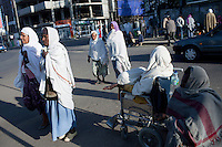 ADDIS ABABA, ETHIOPIA - NOVEMBER 16 : People beg in the streets on November 16, 2010 in central Addis Ababa, Ethiopia. Ethiopia is one of the poorest countries in Africa, but they are trying to change perception on the country. (Photo by: Per-Anders Pettersson)