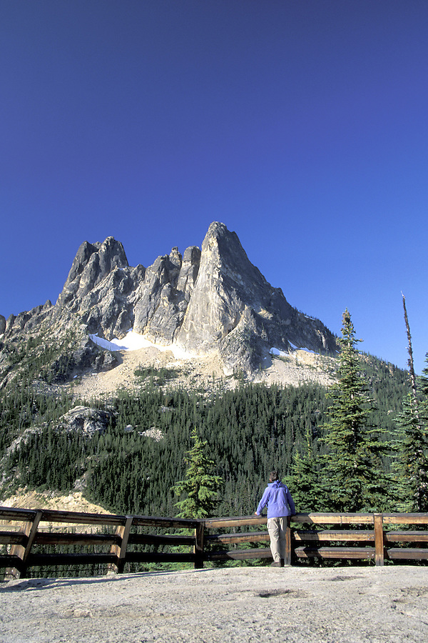 Man standing below Liberty Bell Mountain, Washington Pass Overlook, Hwy 20, North Cascades, Washington