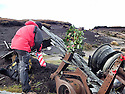 03/11/14<br /> <br /> Pete Jozefczyk , from Glossop Mountain Rescue, lays a wreath and places the American flag on wreckage at a crash site where thirteen airmen were killed when their bomber hit remote moorland high up in the Peak District 66 years ago today.<br /> <br /> Amazingly, the area on Bleaklow Moor is so remote that many of the aircraft&rsquo;s twisted remains, including at least two of engines from the B29 Superfortress still litter the site today.<br /> <br /> The American bomber, known as &lsquo;Over-Exposed!&rsquo; had been converted into a photo reconnaissance aircraft.<br /> <br /> In some of its earlier flights it had been used to photograph the nuclear bomb tests at Bikini Atoll in the Pacific Ocean and had also taken part in the Berlin airlift.<br /> Captain Landon P. Tanner took off on the morning of 3rd November 1948, at around 10.15 from Scampton, Lincolnshire heading on a routine flight to Burtonwood USAF base in Warrington. The B29 was carrying USAF wages among other things. The crew were due to return to the States in a few days.<br /> When &lsquo;Over Exposed!&rsquo; failed to arrive at Burtonwood an air search was initiated, and that afternoon blazing wreckage was spotted high on the moors near Higher Shelf Stones. By chance members of the Harpur Hill RAF Mountain Rescue Unit were just finishing an exercise two and a half miles away, so they quickly made their way to the scene of the crash but there was clearly nothing that could have been done for any of the crew.<br /> This is just one of 180 military and civilian aircraft that have crashed in and around the Peak District since 1918.<br /> <br /> All Rights Reserved - F Stop Press.  www.fstoppress.com. Tel: +44 (0)1335 300098