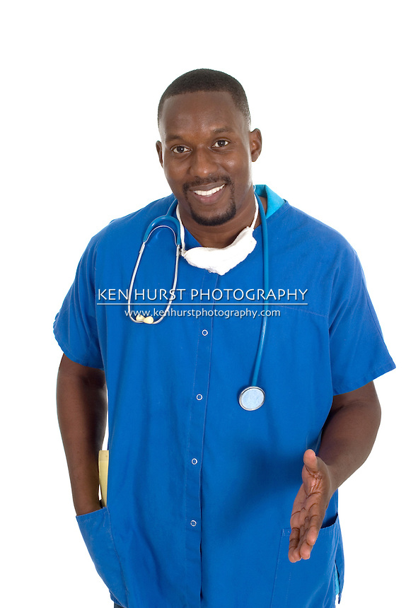 Handsome male doctor or nurse with stethoscope and a reassuring expression.