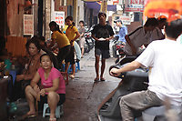 Hanoi<br /> , Vietnam - 2007 File Photo -<br /> <br /> <br /> A young vietnamese carries a plate of rice on a busy sidewalk in hanoi<br /> <br /> <br /> photo : James Wong-  Images Distribution