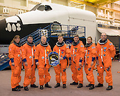 Houston, TX - (FILE) -- The STS-126 crewmembers take a break during a training session on Tuesday, September 30, 2008 for a portrait with their crew logo in the Space Vehicle Mock-up Facility at NASA's Johnson Space Center. From the left are astronauts Heidemarie Stefanyshyn-Piper, Shane Kimbrough, both mission specialists; Eric Boe, pilot; Chris Ferguson, commander; Steve Bowen, Sandra Magnus and Donald Pettit, all mission specialists. Magnus is scheduled to join Expedition 18 as flight engineer after launching to the International Space Station with this crew.  STS-126 is scheduled for launch on Friday, November 14, 2008.  The 15-day flight will deliver equipment and supplies to the space station in preparation for expansion from a three- to six-person resident crew aboard the complex. The mission will include four spacewalks to service the station?s Solar Alpha Rotary Joints..Credit: NASA via CNP