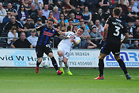 Ryan Williams of Rotherham United battles with Connor Roberts of Swansea City during the Sky Bet Championship match between Swansea City and Rotherham United at the Liberty Stadium in Swansea, Wales, UK.  Friday 19 April 2019
