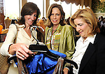 From left: Mary Elizabeth Merrill, Patti Hemingway and Carolyn Crosswell check out some of the great finds at the Salvation Army Women's Auxiliary Luncheon and Fashion Show at the River Oaks Country Club Tuesday April 13,2010. (Dave Rossman Photo)