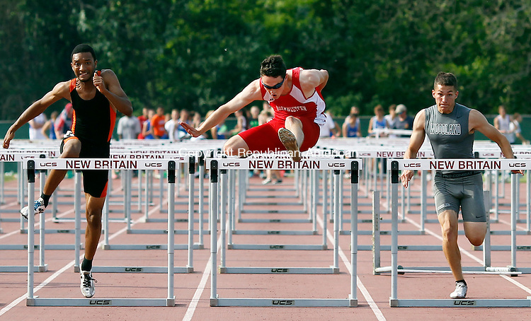 New Britain, CT-29 May 2012-052912CM06-  Northwestern's Dan Santalla (center)  clears the last hurdle 110m hurdles  during the Class M Track and Field Championships.  Santalla won the event and would later set the Class M state record in the 300m hurdles with a time 38.68.   To the right is Woodland's Tim Madormo who placed third in the 110m hurdles.  Christopher Massa Republican-American