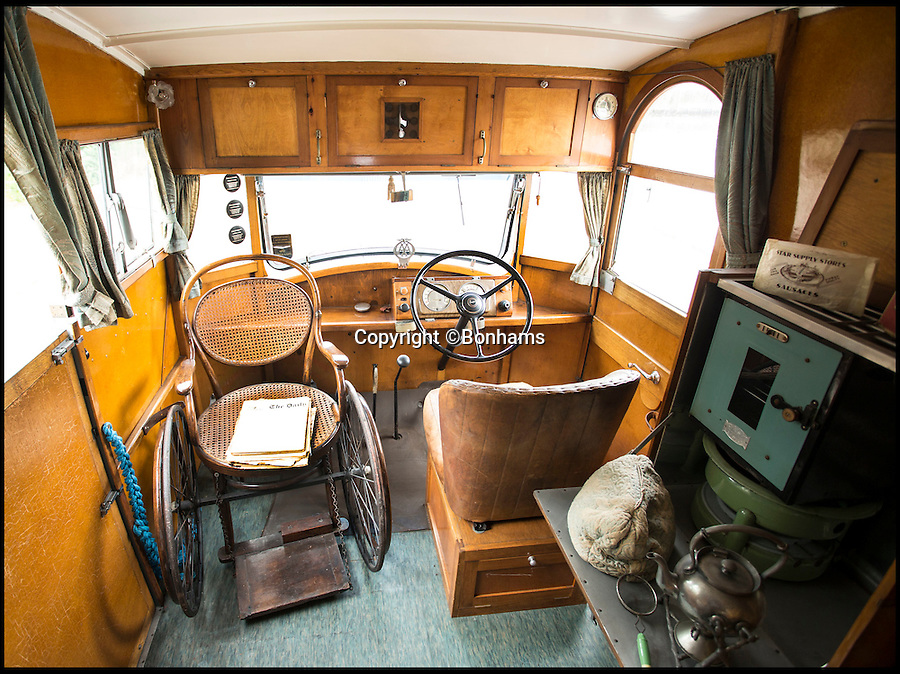 BNPS.co.uk (01202 558833)<br /> Pic: Bonhams/BNPS<br /> <br /> The interior was designed around Capt Dunn's wheelchair after he contracted polio on his honeymoon.<br /> <br /> Britain's first motorhome revealed - As eccentric British pioneers 80 year old home on wheels trundles up for auction.<br /> <br /> The pre-war creation of Capt Dunn, an aristocrat from Bexhill-on-Sea, is believed to be the earliest motorhome in the UK.<br /> <br /> Enterprising Dunn shipped a Pontiac Six chassis over from America in 1935, engaged local coach builders to craft a bespoke<br /> <br /> home from home on to the back, and then set off into the British countryside in his new creation.<br /> <br /> The unique vehicle has been untouched since Dunn died in the 1940's and auctioneers Bonhams are now selling the time capsule<br /> <br /> camper at the Goodwood Revival on 10th September with a £40,000 estimate.