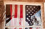 US flag in shop window, Shaniko, Ore.