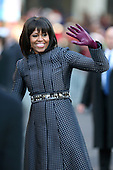 First lady Michelle Obama waves as the presidential inaugural parade winds through the nation's capital January 21, 2013 in Washington, DC. Barack Obama was re-elected for a second term as President of the United States. .Credit: Chip Somodevilla / Pool via CNP